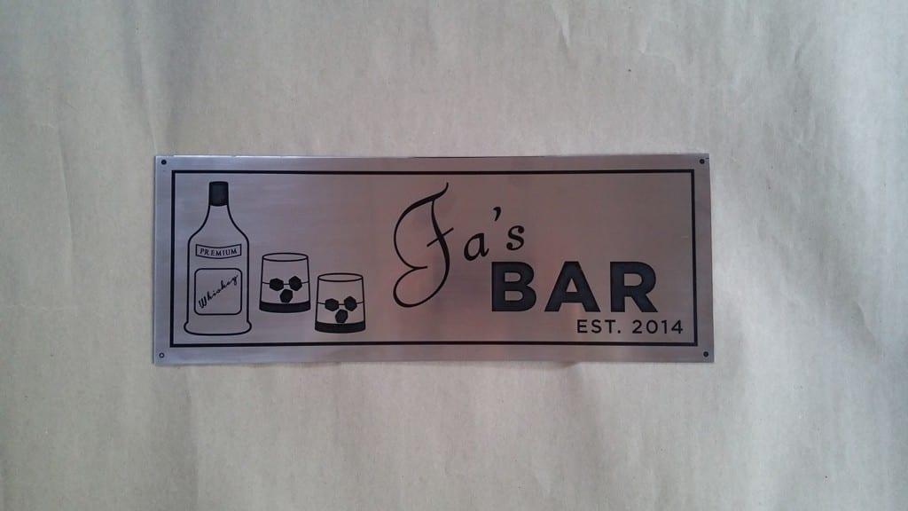 Etched-stainless-steel-sign-with-black-fill-detail